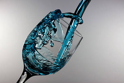 Blue Martini Splashing From A Wine Glass Poster by Paul Ge