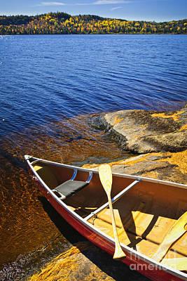 Canoe On Shore Poster by Elena Elisseeva