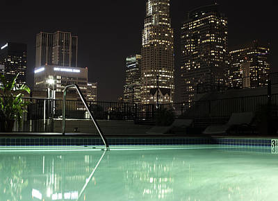City Skyline At Night Photgraphed From A Pool Poster by Frank Rothe