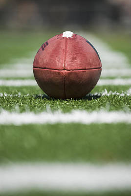 Close Up Of Football On Yard Line Marker Poster by Tetra Images