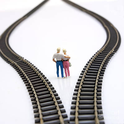 Couple Two Figurines Between Two Tracks Leading Into Different Directions Symbolic Image For Making Decisions Poster by Bernard Jaubert