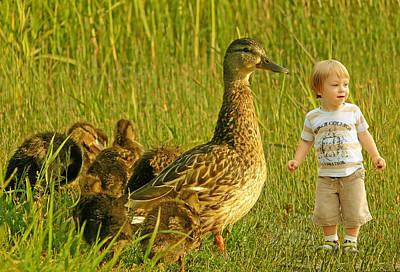 Cute Tiny Boy Playing With Ducks Poster by Jaroslaw Grudzinski