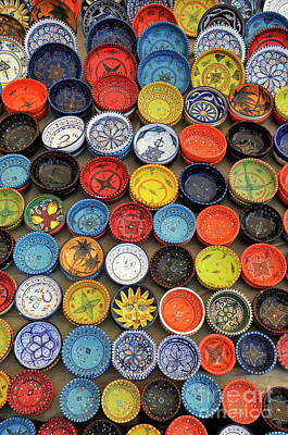 Display Of Colorful Traditional Pottery Plates Poster by Sami Sarkis