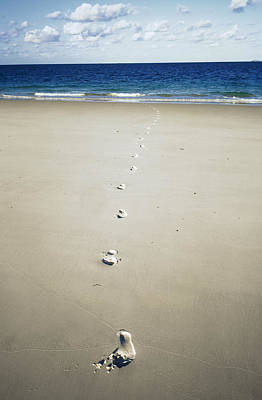 Footprints Poster by Carlos Dominguez