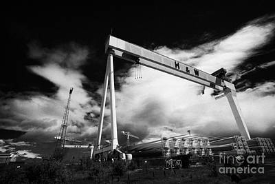 Giant Harland And Wolff Cranes Goliath Amd Samson With Wind Turbine Blades At Shipyard Titanic Poster by Joe Fox