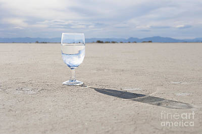 Glass Of Water On Dried Mud Poster by Thom Gourley/Flatbread Images, LLC