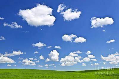 Green Rolling Hills Under Blue Sky Poster by Elena Elisseeva
