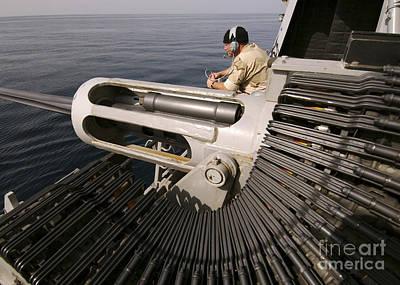 Gunner Manning A Mk-38 25mm Heavy Poster by Stocktrek Images