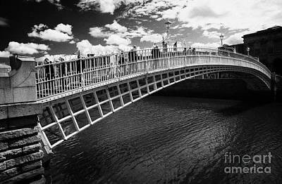Halfpenny Hapenny Bridge Over The River Liffey In The Centre Of Dublin City Republic Of Ireland  Poster by Joe Fox