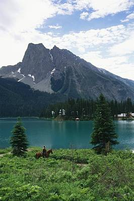 Horseback Riding Around Emerald Lake Poster by Michael Melford