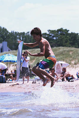 Jumping A Wave On A Skimboard Poster by Christopher Purcell