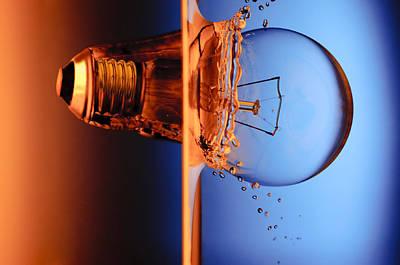 Light Bulb Shot Into Water Poster by Setsiri Silapasuwanchai