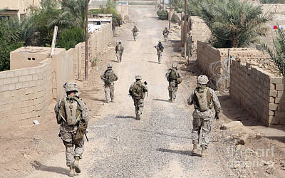 Marines Patrol The Streets Of Iraq Poster by Stocktrek Images