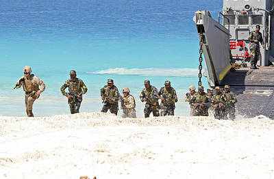Marines Rush Ashore From A Ling Craft Poster by Stocktrek Images
