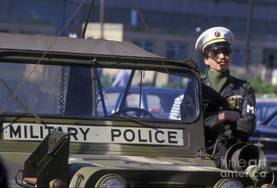 Military Policeman Stands Next Poster by Michael Wood