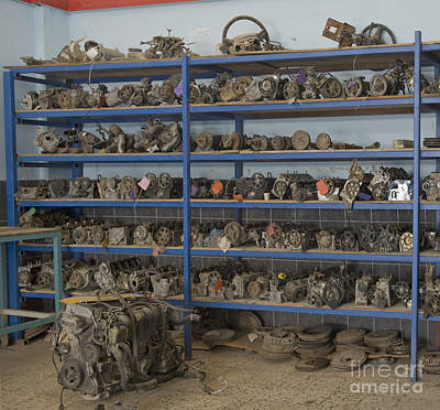 Old Automobile Parts On Shelves Poster by Noam Armonn