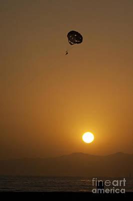 Parasailing At Sunset Poster by Micah May