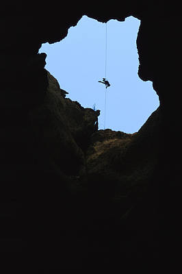 Paul Aughey Climbs Out Of Funnel Cave Poster by Stephen Alvarez