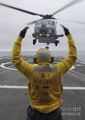 Petty Officer Guides An Sh-60r Sea Hawk Poster by Stocktrek Images