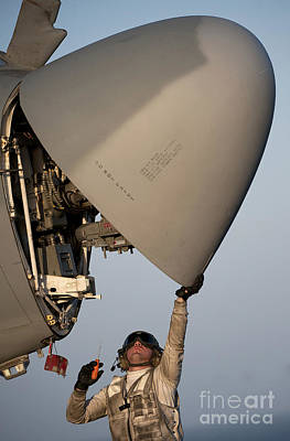 Petty Officer Inspects The Radar Of An Poster by Stocktrek Images