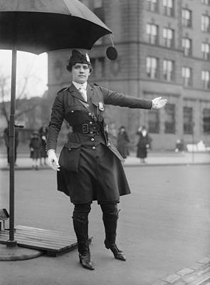 Policewoman Directing Traffic Poster by Everett