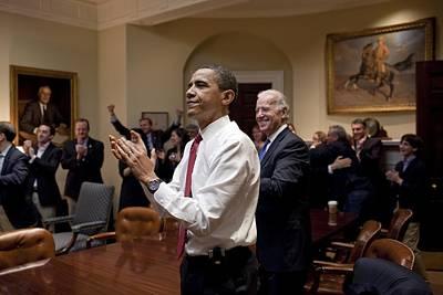 President Obama And Vp Biden Applaud Poster by Everett
