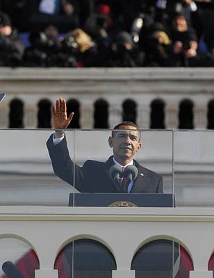 President Obama Gestures As He Delivers Poster by Everett