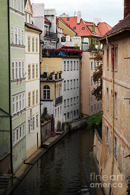Red Rooftops In Prague Canal Poster by Linda Woods