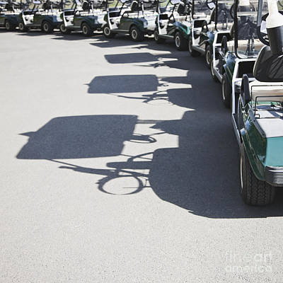 Row Of Empty Golf Carts Poster by Jetta Productions, Inc