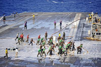 Sailors Perform A Flight Deck Wash Poster by Stocktrek Images