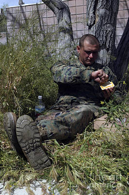 Soldier Takes Advantage Of A Break Poster by Stocktrek Images