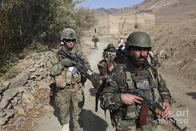 Soldiers Patrol The Depak Valley Poster by Stocktrek Images
