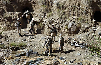 Soldiers Search Caves Near Kahrkia Poster by Stocktrek Images