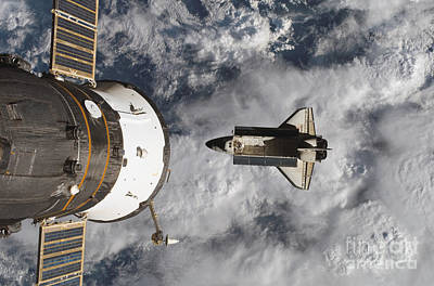 Space Shuttle Atlantis And The Docked Poster by Stocktrek Images