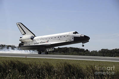 Space Shuttle Atlantis Touches Poster by Stocktrek Images