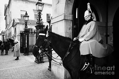 The Household Cavalry Life Guards On Guard Duty In Whitehall London England Uk United Kingdom Poster by Joe Fox
