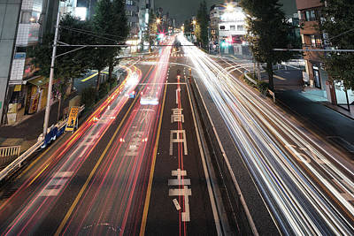 Traffic Trails At Night, Tokyo Poster by Spiraldelight