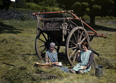 Two Girls Eat Lunch In A Hayfield Poster by Clifton R. Adams