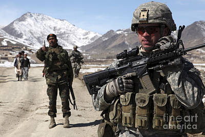 U.s. Army Soldier Conducts A Patrol Poster by Stocktrek Images