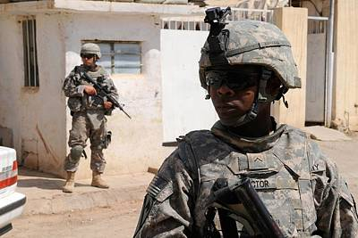 Us Army Soldiers On Patrol In Kirkuk Poster by Everett