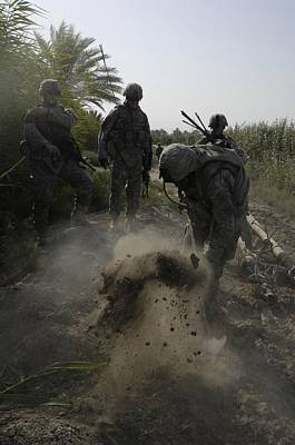 Us Army Soldiers Search For Buried Poster by Everett