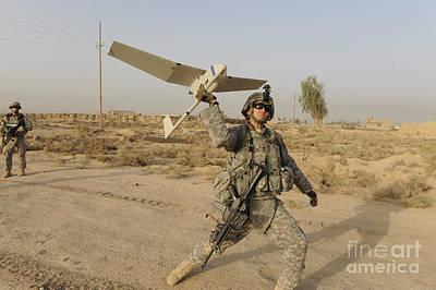 U.s. Army Specialist Launches An Rq-11 Poster by Stocktrek Images