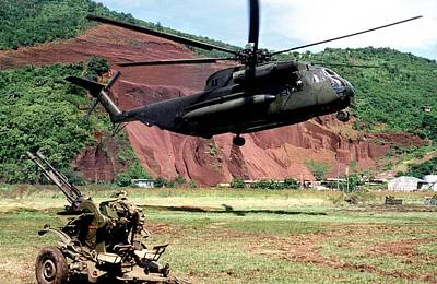 U.s. Marine Corps Helicopter Hovers Poster by Everett
