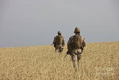 U.s. Marines Patrol A Wadi Near Kunduz Poster by Terry Moore