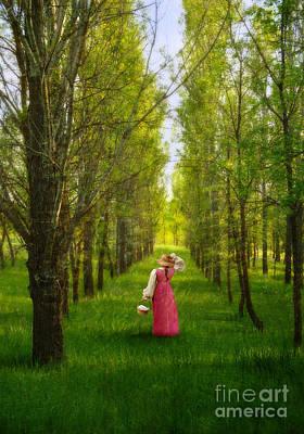 Woman In Vintage Pink Dress Walking Through Woods Poster by Jill Battaglia