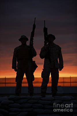 Silhouette Of U.s Marines On A Bunker Poster by Terry Moore