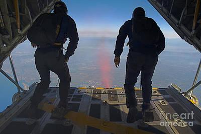 Members Of The U.s. Navy Parachute Team Poster by Stocktrek Images