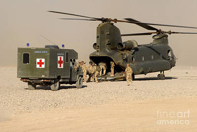A Ch-47 Chinook Helicopter Drops Poster by Andrew Chittock