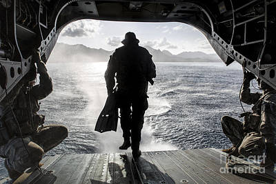 A Soldier Conducts A Combat Dive Poster by Stocktrek Images