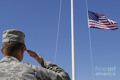 A Soldier Salutes The American Flag Poster by Stocktrek Images